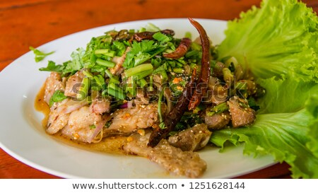 Stock photo: Grilled pork with salad greens
