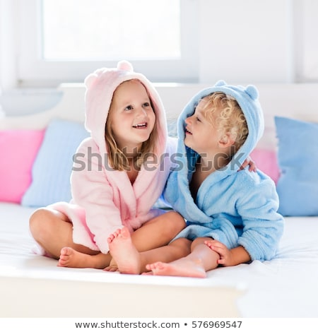 boy and girl in bed stock photo © bluering