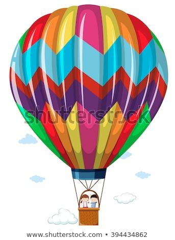 Children riding in the hotair balloon Stock photo © bluering