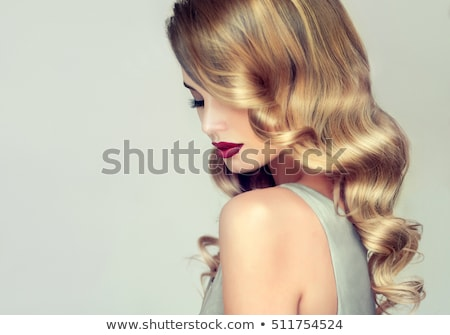 Beautiful blonde girl with red lipstick and long hair Stock photo © deandrobot