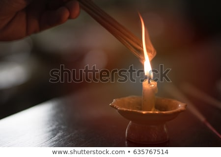 Candlestick and burning candle and in the background a  incense  Stock photo © nessokv