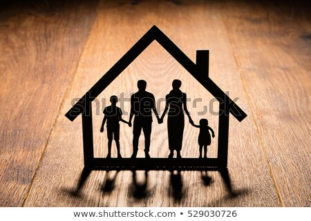 Family Papercut On Wooden Desk Stock photo © AndreyPopov