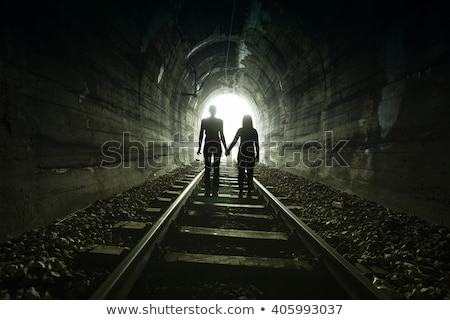 Photo stock: Couple Walking Together Through A Railway Tunnel