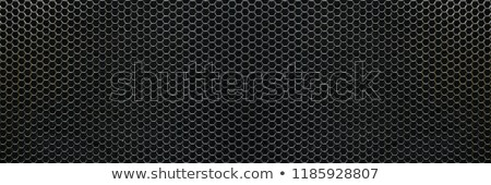 metal background with hexagonal shapes holes stock photo © sarts