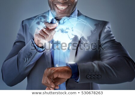 close up of hands and globe hologram on smartwatch stock photo © dolgachov