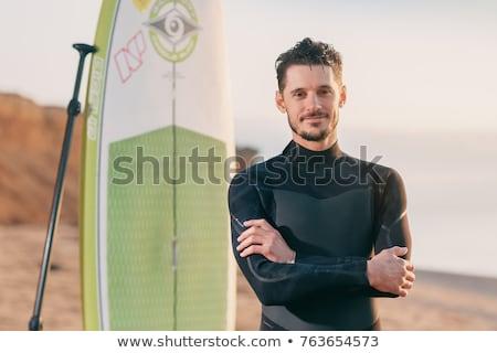 Gülen sörfçü sörf ayakta plaj sahil Stok fotoğraf © wavebreak_media