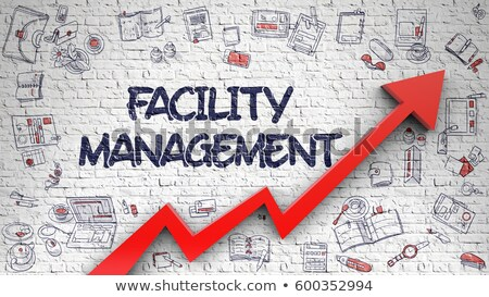 facility management drawn on white brick wall stock photo © tashatuvango