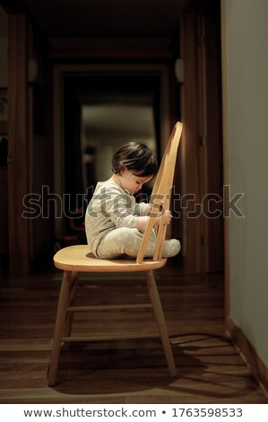 sad young casual woman sitting on chair stock photo © feedough