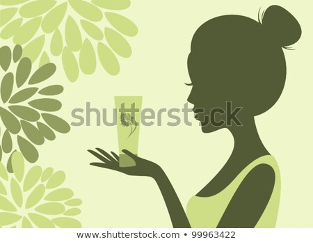 Silhouette of a woman holding a bottle Stock photo © CsDeli