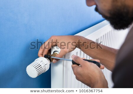 Human Hand Installing Radiator Stock photo © AndreyPopov