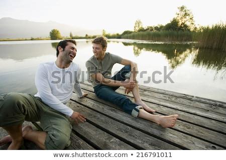 Dwie osoby posiedzenia boso jezioro kobieta człowiek Zdjęcia stock © IS2