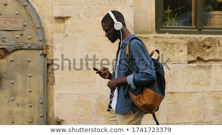 side view of a young casual man wearing glasses  Stock photo © feedough