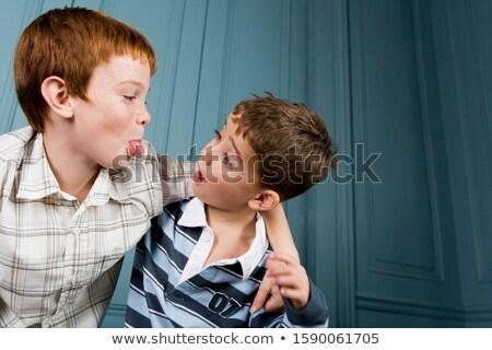 Dwa chłopców chłopca ramię około Zdjęcia stock © IS2