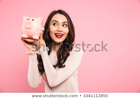 Smiling girl holding a piggy bank Stock photo © IS2