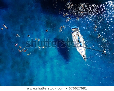 white boats sailing on turquoise sea stock photo © mikko