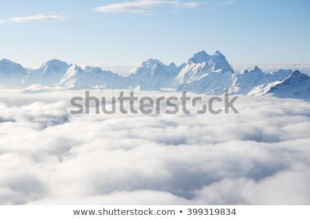 Caucasus mountaines with clouds Stock photo © olgaaltunina