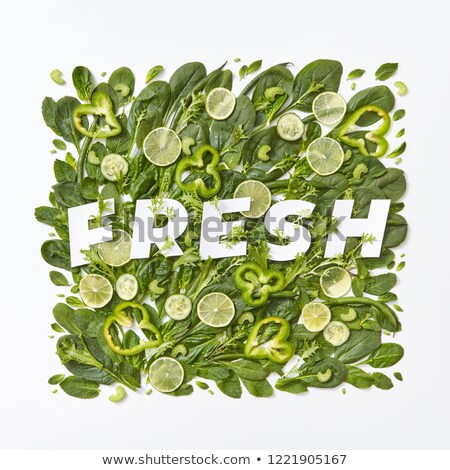 Fresh spinach, cabbage, asparagus pieces of pepper, cucumber and flower petals on a gray background. Stock photo © artjazz