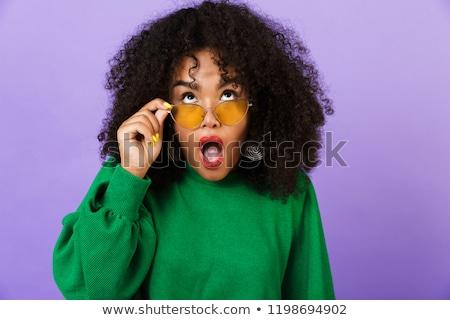 Geschokt mooie afrikaanse vrouw geïsoleerd violet Stockfoto © deandrobot