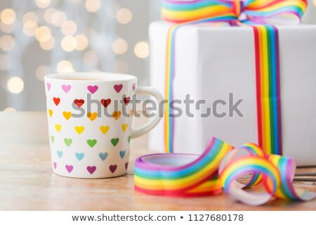 close up of cup, gift box and gay awareness ribbon Stock photo © dolgachov