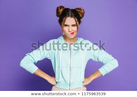 Portrait of angry woman with two buns twisting mouth with furiou Stock photo © deandrobot