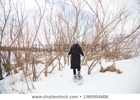 beautiful woman on the blue sky of Quebec winter Stock photo © Lopolo
