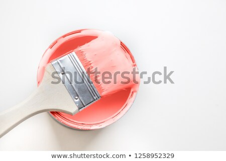 Paintbrush with liquid paint in a color of the year 2019 Living Coral Pantone in color isolated on a Stock photo © artjazz