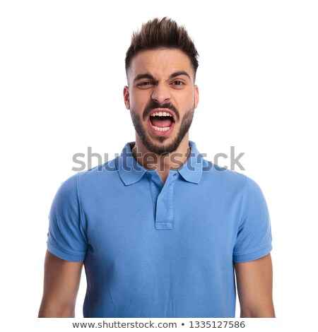 Young man wearing a light blue polo shouting out loud Stock photo © feedough