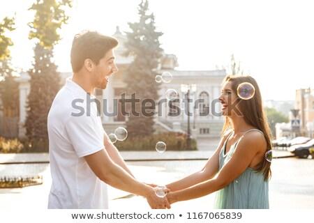 Liefhebbend paar lopen buitenshuis holding handen ander Stockfoto © deandrobot