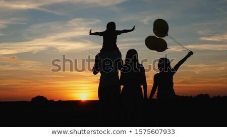 Anne çocuk balon gün batımı örnek kız Stok fotoğraf © adrenalina