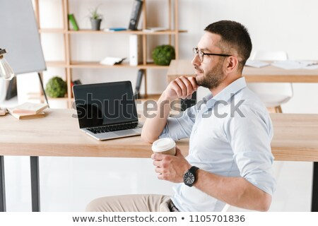 Profile image of diligent office man 30s in white shirt sitting  Stock photo © deandrobot