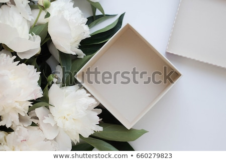 Stock photo: Pink peony flowers and gift box