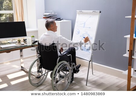 Handicapped man drawing Stock photo © pressmaster