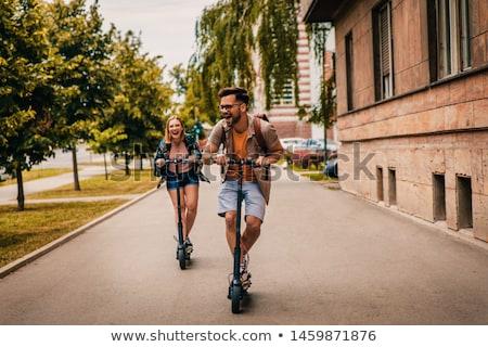 Fiatalember lovaglás elektromos moped fiatal üzletember Stock fotó © AndreyPopov