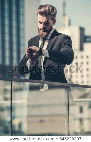 Executivo apressar empresário olhando ver mão Foto stock © Freedomz