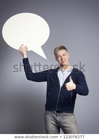Joyful man giving thumbs up at blank signboard.  Stock photo © lichtmeister