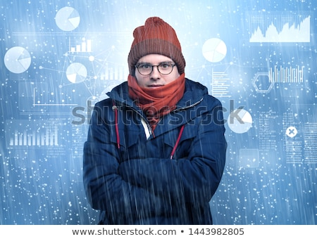 Young hipster shivering with graphs, reports and chart concept Stock photo © ra2studio