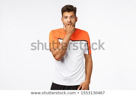 Nyugtalan aggódó fiatal jóképű férfi atléta Stock fotó © benzoix