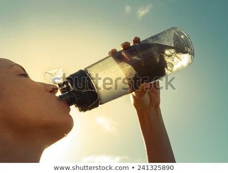 genç · heyecanla · şişe · su · güzel - stok fotoğraf © gsermek