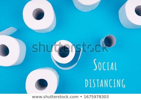 Coronavirus pandemic panic shopping concept. Flat lay of Toilet paper rolls Stock photo © Illia