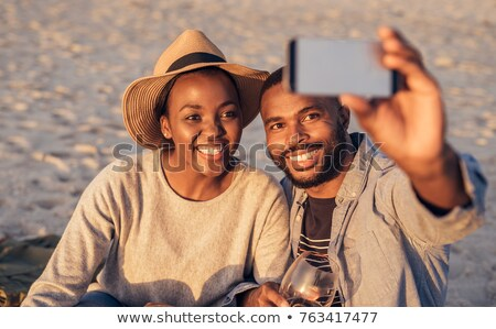 Woman on Vacation, Picnic on Nature Taking Selfie Stock photo © robuart
