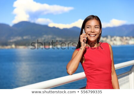 Happy asian woman talking on the phone in vancouver city harbour on summer day. Beautiful landscape  Stock photo © Maridav