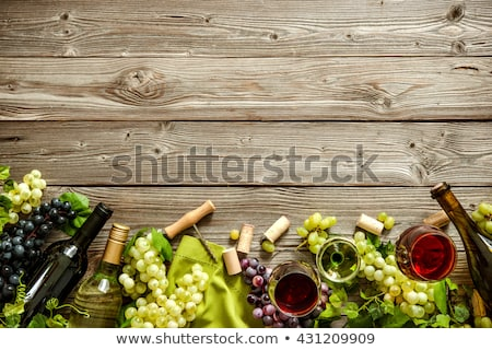 Wine cork with vintage corkscrew on top on wood background with glass and bottle of red wine Stock photo © DenisMArt