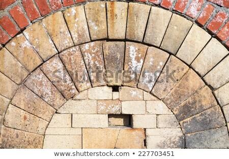 Baksteen hoek lang Rood ongebruikelijk steen Stockfoto © bobkeenan