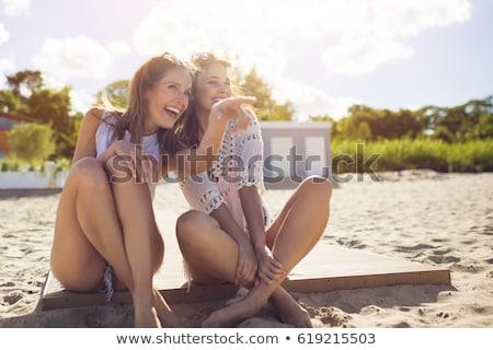Mulher jovem indicação praia em pé mulher menina Foto stock © pkirillov