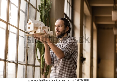 Architect holding a building model Stock photo © photography33
