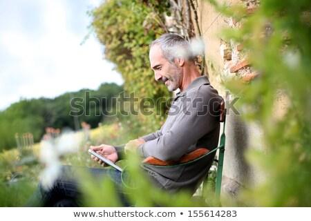 érett férfi vidék ház virágok mosoly út Stock fotó © photography33