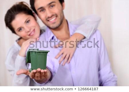 Couple holding miniature bin Stock photo © photography33