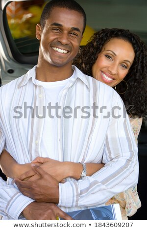 Couple excitedly looking at a catalogue Stock photo © photography33