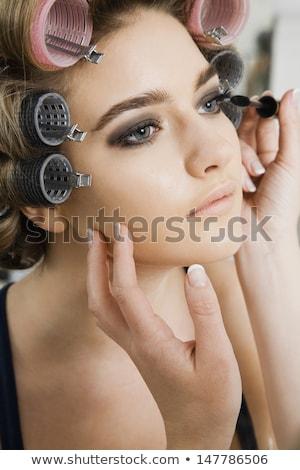 Makeup mascara woman with hair rollers Stock photo © Ariwasabi