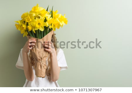 girl with a bunch of daffodil stock photo © leeavison